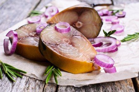 Smoked mackerel, sliced, with onions and rosemary ...