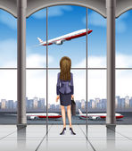 Woman looking at the plane taking off