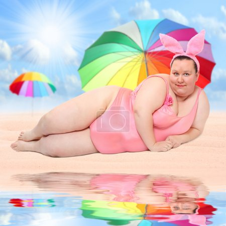 Overweight woman on a tropical beach.