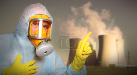 Man in protective suit with gas mask