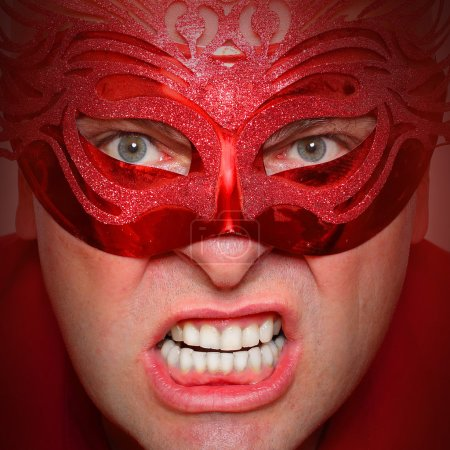 Photo for Close up portrait of angry man in red mask. Mental health concept. - Royalty Free Image