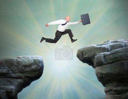 Senior businessman jumping to new job