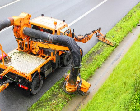 Maintenance on the highway mowing the lawn.