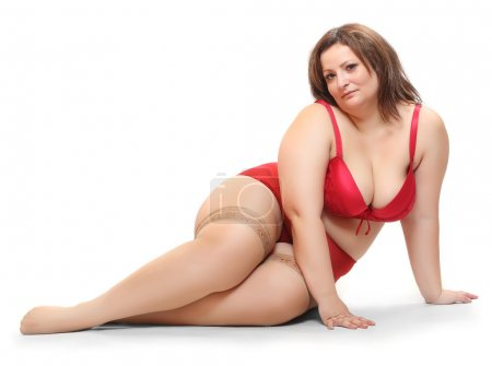 Overweight woman dressed in retro underwear