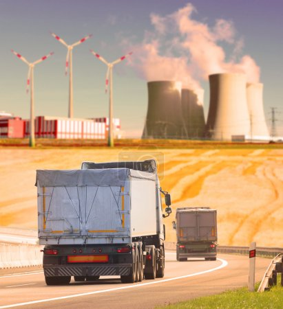 Trucks on the highway in industrial landscape