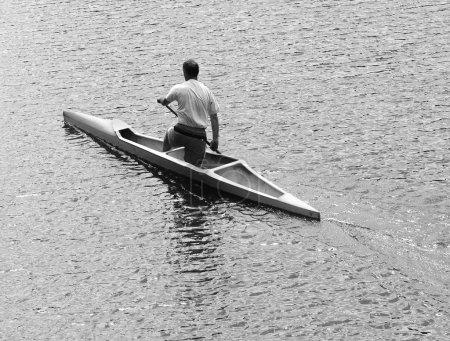 Young man canoeing in the lake