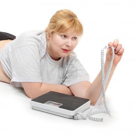 Overweight woman with measure tape