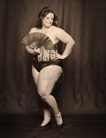 Overweight woman dressed in corset
