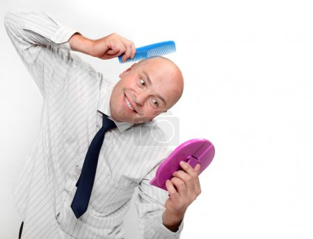 Hairless businessman with mirror - forever beautif...