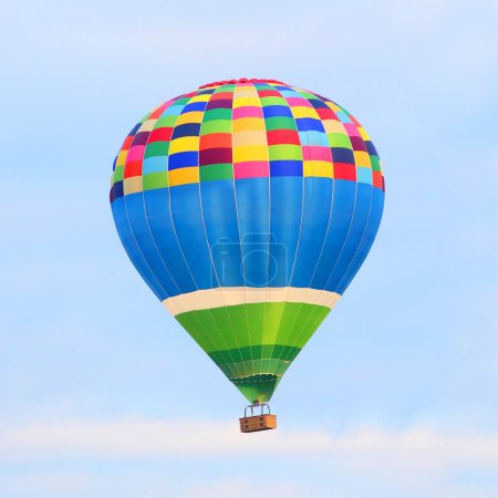 Colorful hot air balloon on the sky.