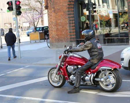 Motorcycle rider waiting at red light at Downtown Hannover