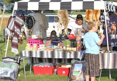 Unidentified boy  checking out vendors during Anderson Town Pow Wow