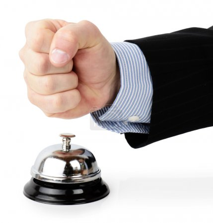 Photo pour Customer complaint . Concept of a customer complaint hitting a service bell in an angry gesture isolated on a white background - image libre de droit