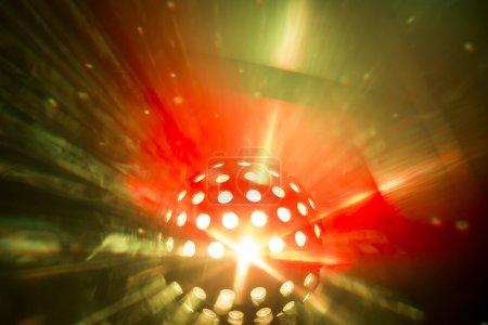 disco light shining through fog