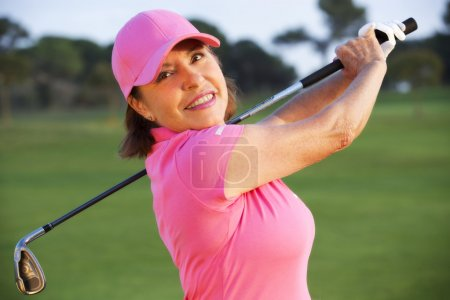 beautiful senior female golf player