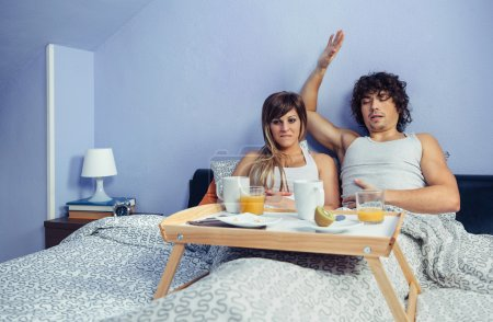 Young couple with stomach pain after eat breakfast