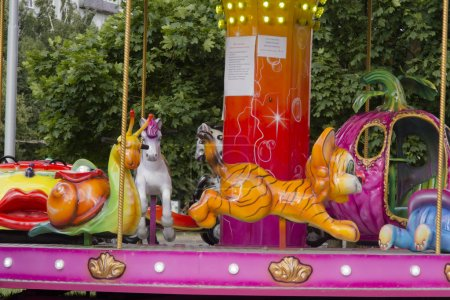Carousel animals as kids attraction in luna park