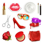 Red ladies handbag with cosmetics and accessories