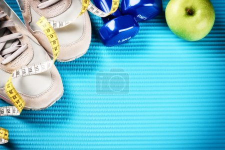 Photo for Fitness frame with dumbbells, sneakers and green apple. Healthy lifestyle concept with copy space - Royalty Free Image