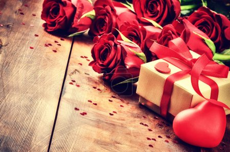 Valentine's setting with bouquet of roses and present