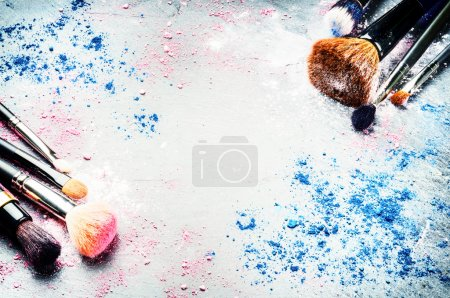 Photo for Makeup brushes and crushed eyeshadows on dark background - Royalty Free Image
