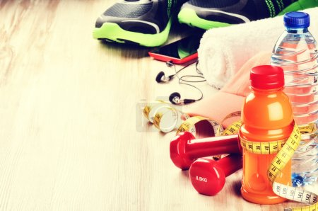 Fitness concept with dumbbells, fruits juice
