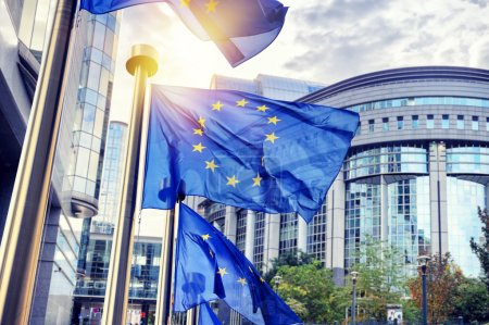 Photo for EU flags waving in front of European Parliament building. Brussels, Belgium - Royalty Free Image