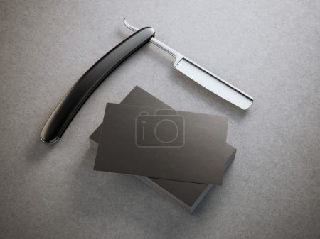 Razor with stack of business cards