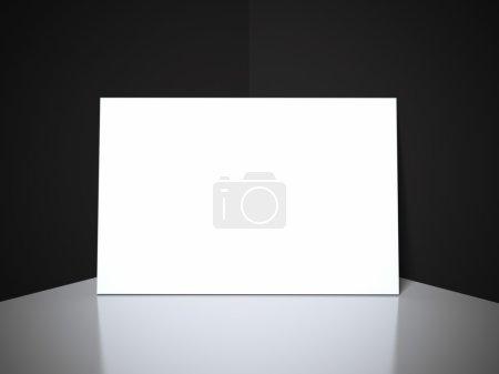 White blank business card in black studio