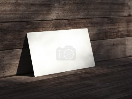 White business card on the wooden floor. 3d rendering