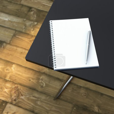Notebook with pen on table