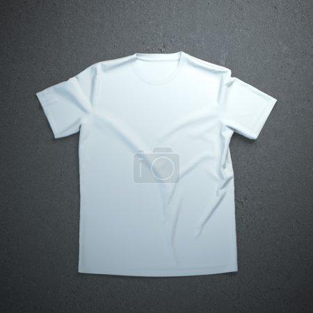 Foto de Camiseta blanca aislado en el fondo de hormigón - Imagen libre de derechos