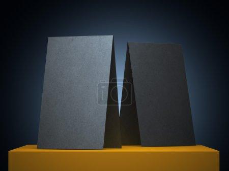 Photo pour Deux plié des cartes de visite noirs sur jaune cube - image libre de droit