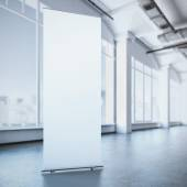 White roll up banner in a modern interior. 3d rendering