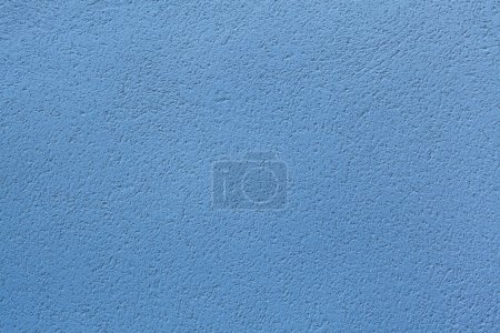 Blue painted stucco wall.