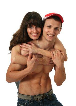 Woman embracing her muscular boyfriend