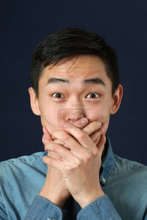 Surprised young Asian man