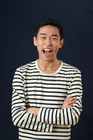Laughing young Asian man