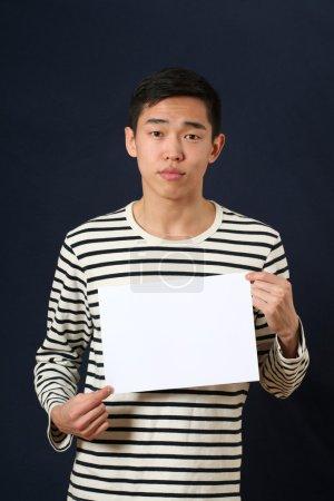Man showing white  page