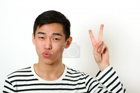 Satisfied young Asian man