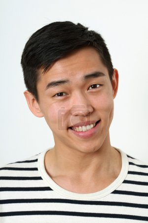 Photo for Laughing young Asian man looking at camera. - Royalty Free Image