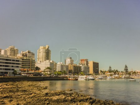 Buildings and boats in a beautiful and tranquil su...