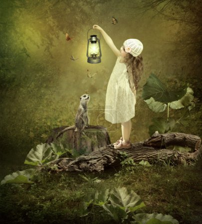 Photo for Little girl with long hair, with the magic lamp in his hand in the forest and meerkat, surrounded by butterflies - Royalty Free Image