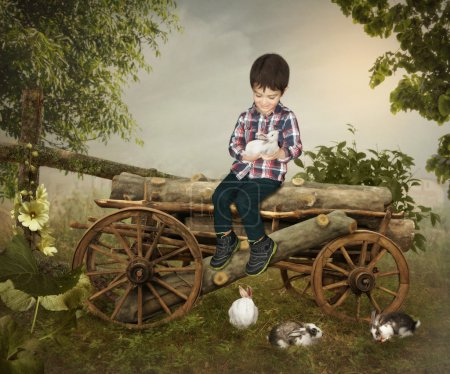 Kid  sitting on logs with  rabbits
