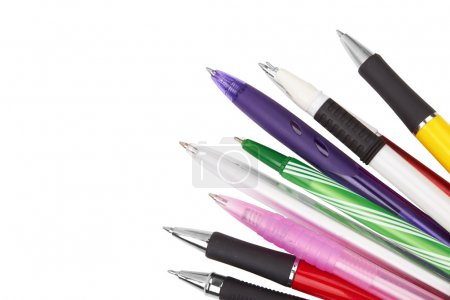 Different kinds of pens isolated on white backgrou...