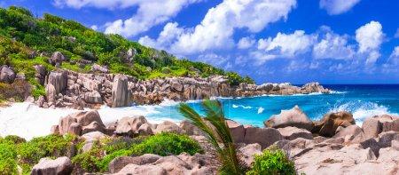 impressive wild rocky beach Anse Marron in Seychelles. La Digue