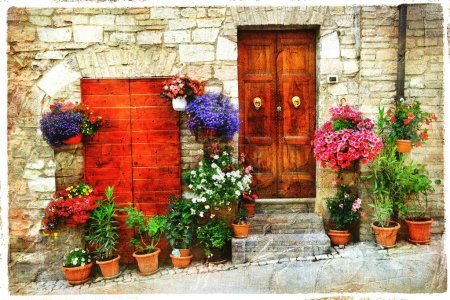 beautiful floral streets of old italian village. Spello, artisti