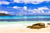 tropical paradise -islands Seychelles, view with sailboat