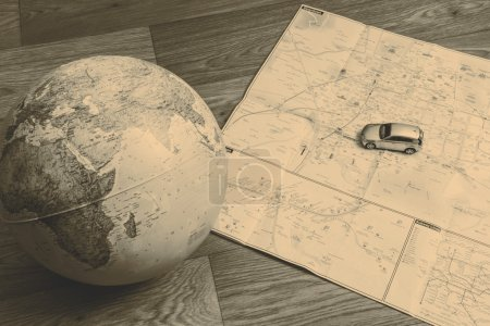 globe and map on the wooden floor