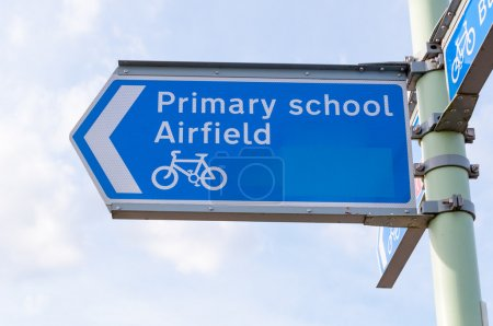 Metal sign post for Primary School, Airfield and cycle path